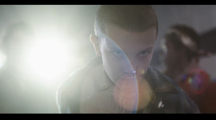 Eleven (Millie Bobby Brown) uses telekinetic powers to protecther friends from government cronies.