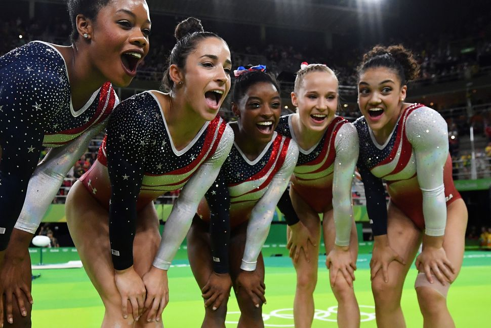 US gymnasts celebrate after the women's team final Artistic Gymnastics at the Olympic Arena during the Rio 2016 Olympic Games