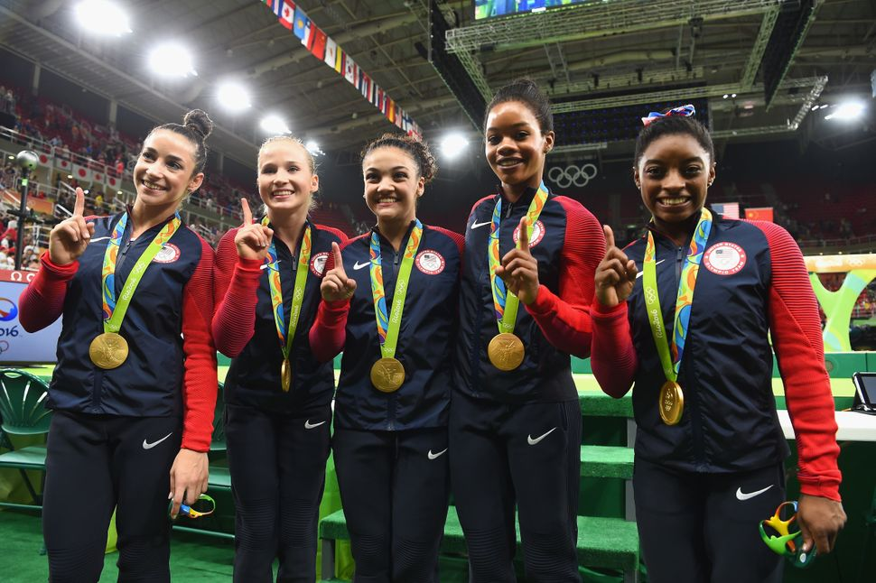 RIO DE JANEIRO, BRAZIL - AUGUST 09: (L to R) Gold medalists Alexandra Raisman, Madison Kocian, Lauren Hernandez, Gabrielle Do