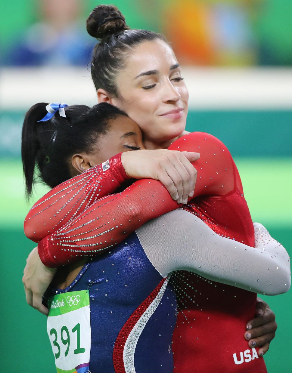 Gymnastics - Olympics: Day 6  Simone Biles of the United State and Alexandra Raisman of the United States embrace as the fina