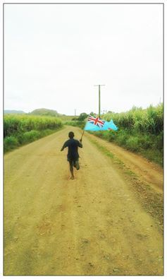 This child running to the closest television half a mile away to cheer on the Fijians.