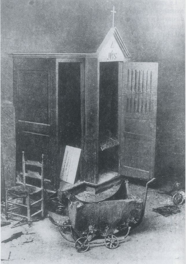 <i>A bullet-riddled baby carriage at the base of the confessional</i>