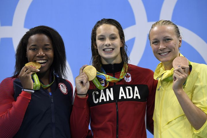 Simone Manuel, Penny Oleksiak and Sarah Sjostrom with their medals for the 100 meter freestyle.