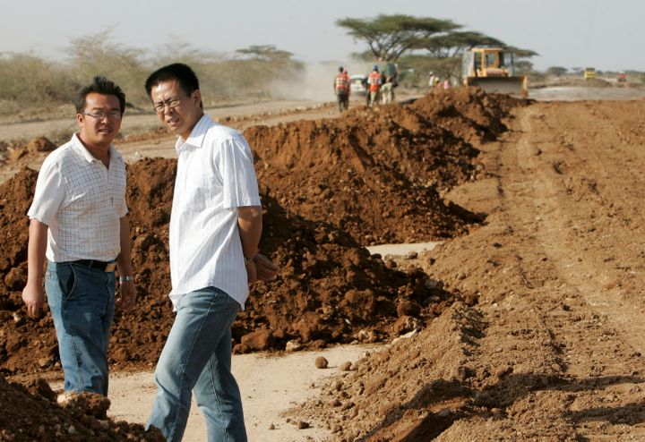 Aroad construction project manager with China Wuyi Company talks to a colleague at a site near Isiolo town, about 320 k