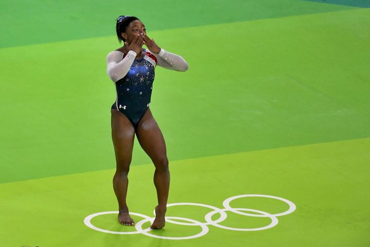 Simone Biles signals to the crowd after winning the gold medal in the women's individual all around final on Thursday.