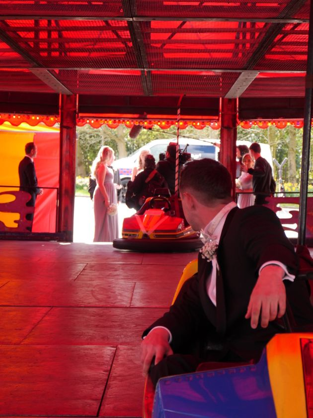 Lawrence waits for his bride to ride down the aisle in a bumper