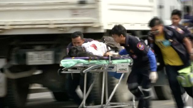 Medics rush an injured person from the scene of the bombing; at least four people died in the bombings...