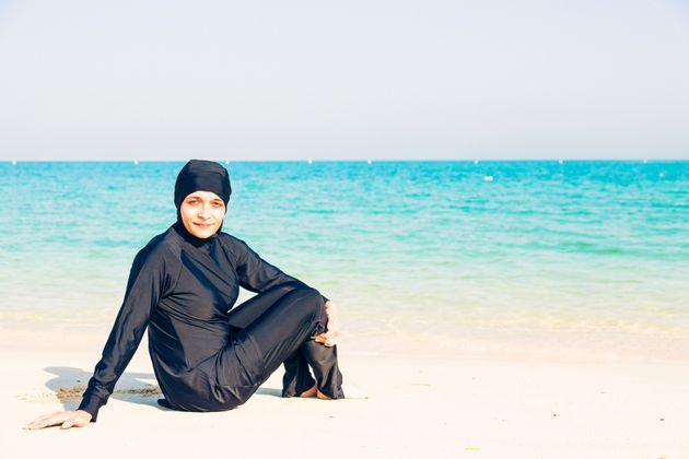 A young woman wearing a burkini on a beach in Dubai (file