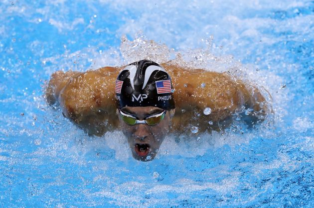 Michael Phelps takes part in the men's 200m individual
