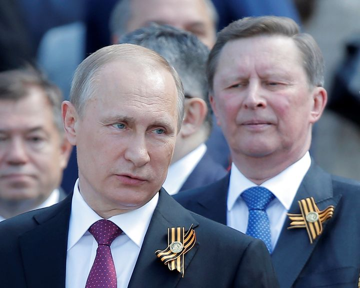 Russian President Vladimir Putin says his long-time ally, Sergei Ivanov, right, had asked to step down.