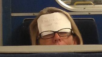 PIC BY MERCURY PRESS (PICTURED: THE NOTE ON THE SLEEPING WOMANS HEAD SAYING WAKE ME UP AT HARPENDEN)A crafty commuter found the perfect way to make sure she didnt snooze through her stop  by sticking a plea about which stop to wake her up at to her FOREHEAD. The woman was catching 40 winks while on a late-night service travelling from Kings Cross last week and fixed the handwritten note toher head using her glasses, which read Wake me up at Harpenden.  Marketing intern Jordan Miguel spotted the makeshift alarm clock at around 11.50pm while travelling back to Mill Hill after having post-work drinks with colleagues in central London. SEE MERCURY COPY