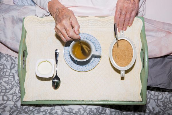 Marisa Vesco eats breakfast in her bed at her home in Cossato, Italy, June 24, 2015. Marisa suffered from liver cancer and a