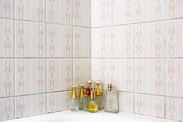 Marisa Vesco'•s perfume bottles, almost all of which were empty, sit on the edge of the bath at her home in Cossato, Italy, F