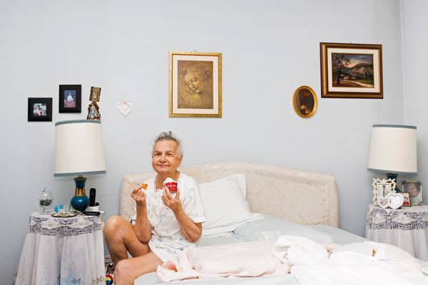 Marisa Vesco eats ice cream in her bed in Cossato, Italy, June 30, 2015. Marisa suffered from liver cancer and a loss of appe
