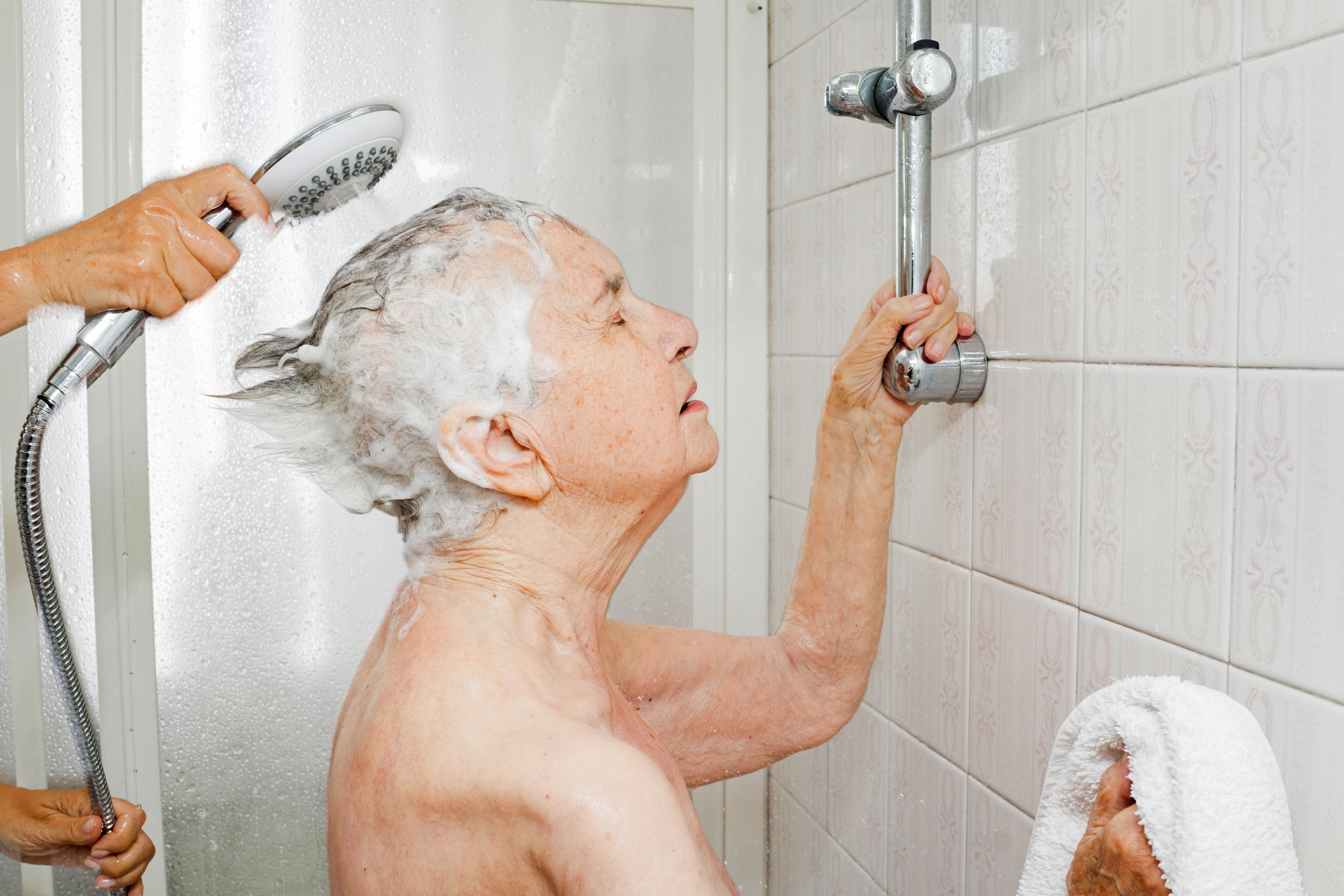 """Chiara Micheletti helps her mother Marisa Vesco take a shower in Cossato, Italy, June 7, 2015. Marisa suffered from incurable liver cancer and in the last months of her life she was not able to bathe herself. Her daughter Chiara cherished the time she was able to help her mother. REUTERS/Gaia Squarci            SEARCH """"ITALY CANCER"""" FOR THIS STORY. SEARCH """"THE WIDER IMAGE"""" FOR ALL STORIES.      TPX IMAGES OF THE DAY"""