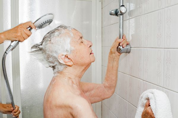 Chiara Micheletti helps her mother Marisa Vesco take a shower in Cossato, Italy, June 7, 2015. Marisa suffered from incurable