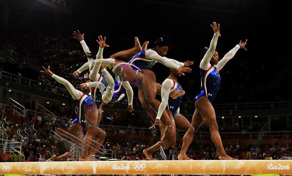 Simone Biles of the United States competes on the balance beam during the Women's Individual All Around Final on Day 6.
