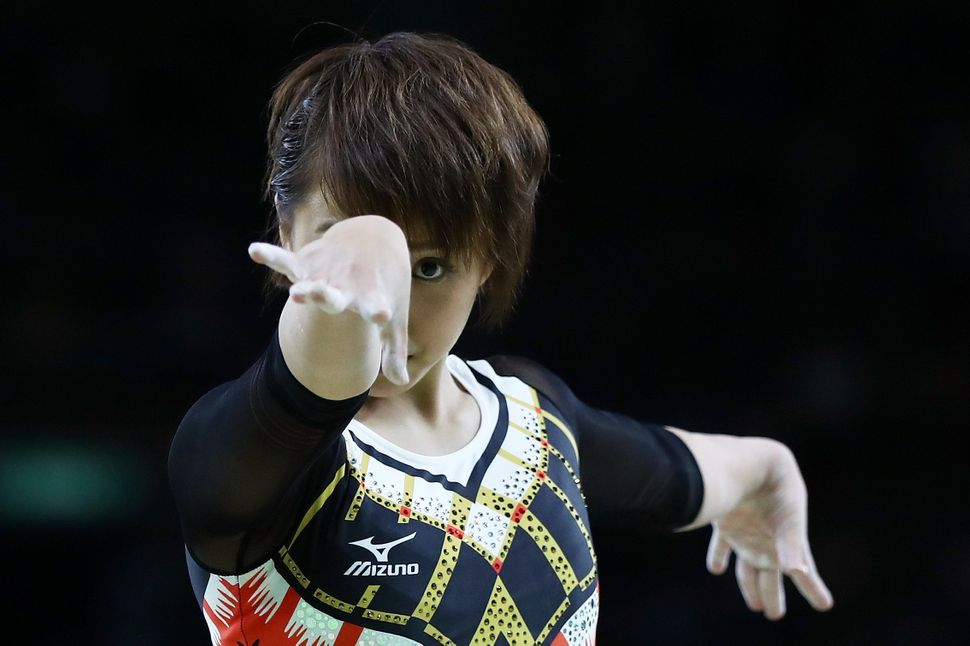 Mai Murakami of Japan competes on the balance beam during the Women's Individual All Around Final.