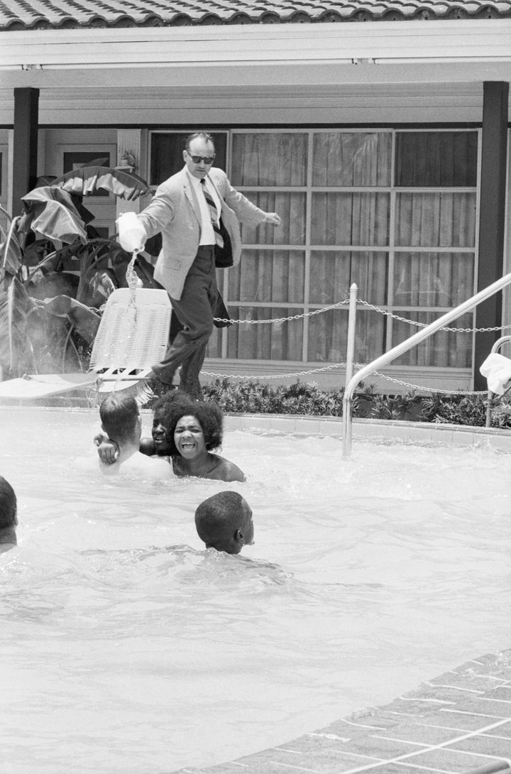Protesters demonstrating in the swimming pool of the Monson Motor Lodge in Saint Augustine, Florida, scream as motel manager