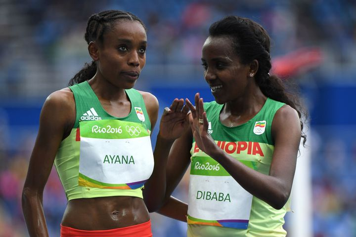 Ayana, left, celebrates with teammate Tirunesh Dibaba after they won gold and bronze respectively in the women's 10,000