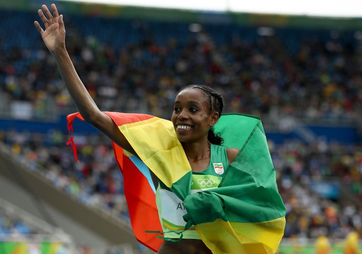 Ayana celebrates winning the Women's 10000 Meters Final on Friday.