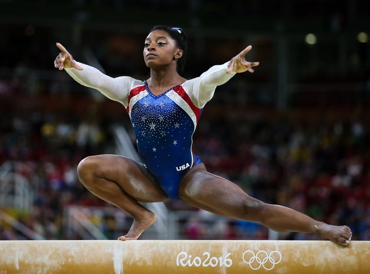 Simone Biles of the USA performs her balance beam routine during the artistic gymnastics women's individual all-around final
