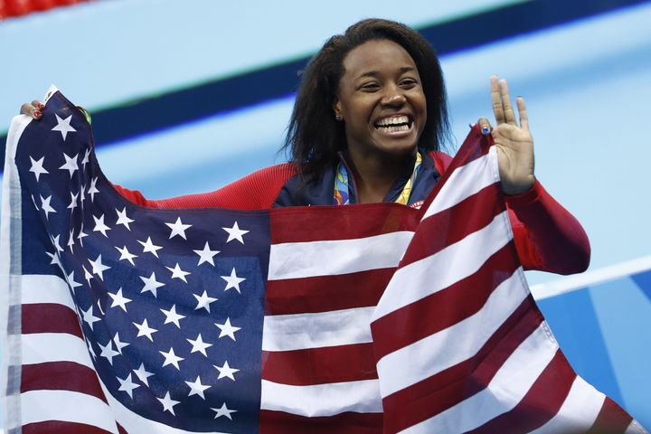 Gold medalist USA's Simone Manuel celebrates her historic win at the Rio 2016 Olympic Games.