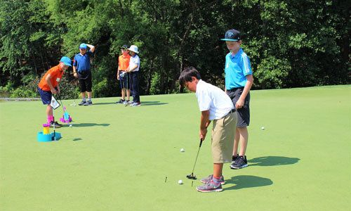 Children participate in the Trumpeteers program at the Trump National Golf Club Charlotte.