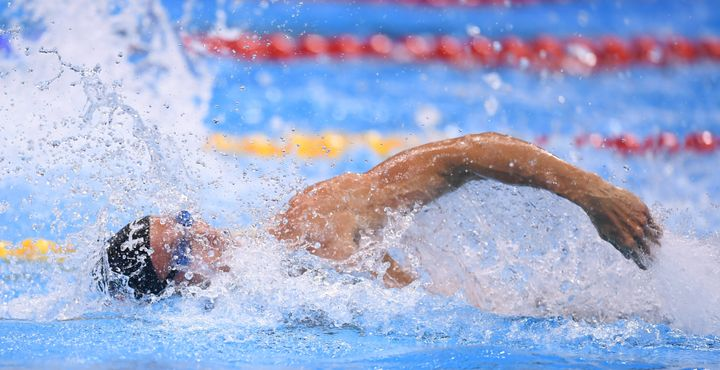 Fabien Gilot of France competes in the heats of the men's 4x100m freestyle relay event at the Olympic Aquatic Stadium during
