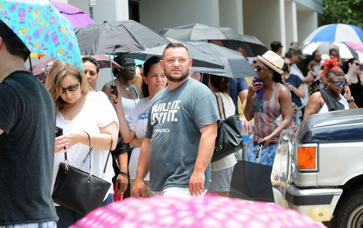 ORLANDO, FLORIDA - JUNE 12: People wait in line to donate blood at the OneBlood Donation Center for the victims of a terror a