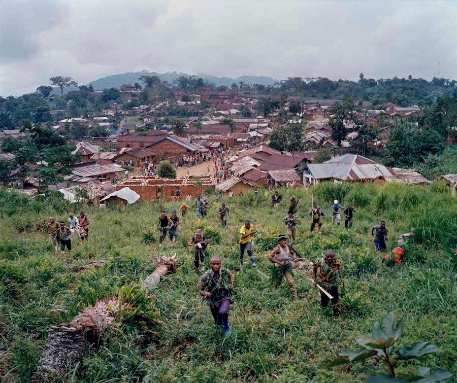 Dec. 18, 2013. Lulingu, South Kivu, Democratic Republic of the Congo. On the hills above Lulingu town, fighters demonstrate a