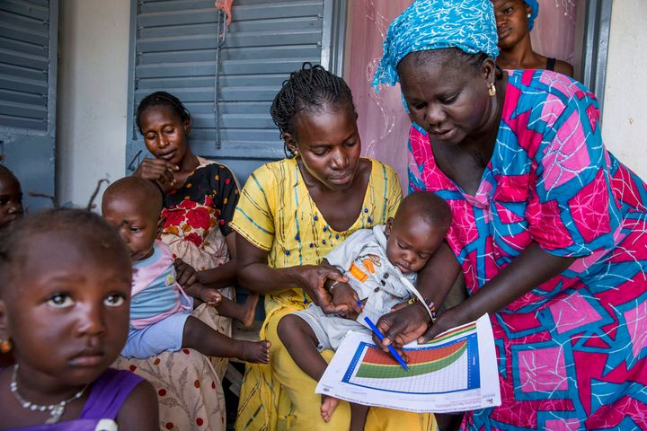 A community health worker in Kaolack, Senegal, providing women in her community counseling and postnatal care at her home. Th