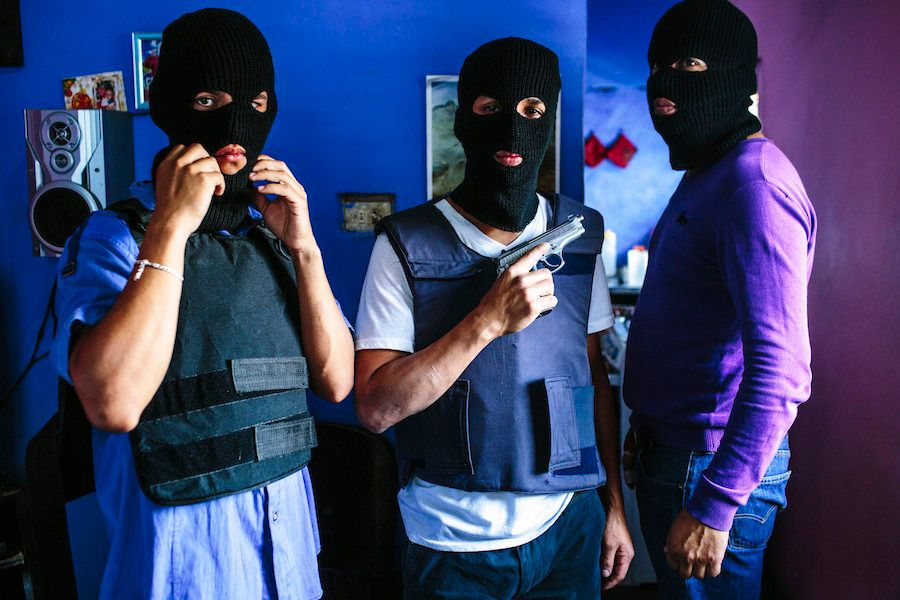 March 22, 2015. Caracas. A gang from Western Caracas poses for a portrait at one of their stash houses in the barrio. Crime,