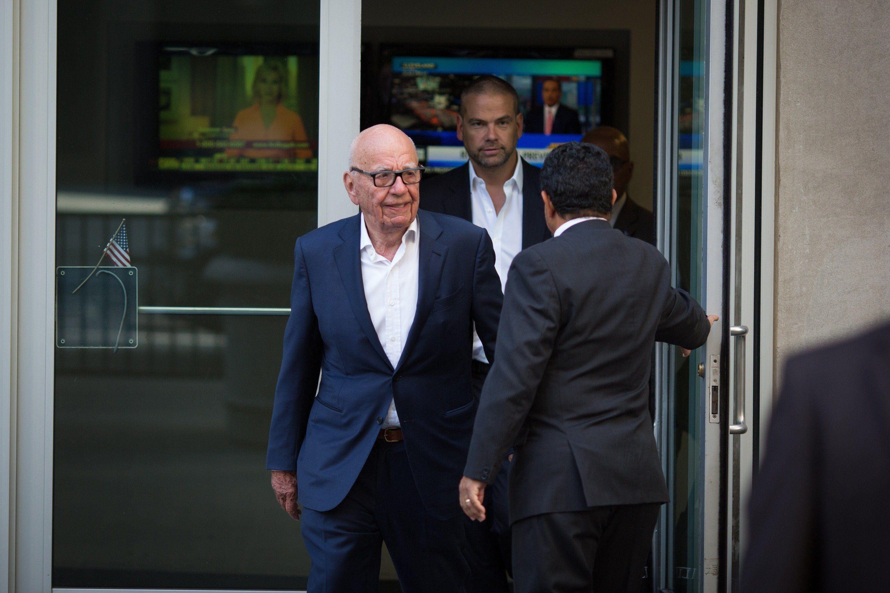 NEW YORK, NY - JULY 21: Rupert Murdoch leaves the News Corporation building with his son Lachlan Murdoch (R) on July 21, 2016 in New York City. Rupert Murdoch is taking over as Chairman and CEO of Fox News Channel after former Chairman and CEO Roger Ailes departed the company today amid sexual harassment charges. (Photo by Kevin Hagen/Getty Images)