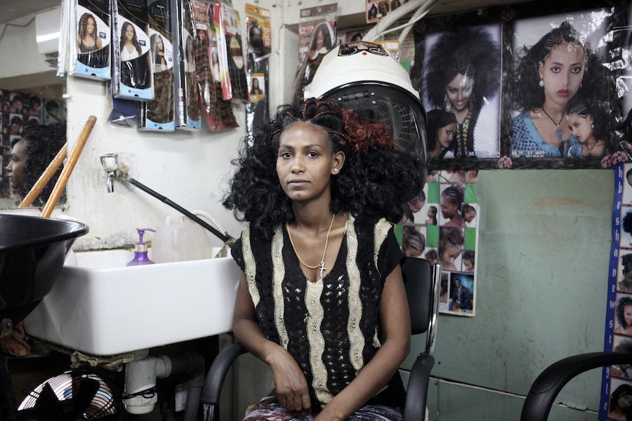 An Ethiopian woman after getting her hair done for Church near Levinsky Park, South Tel Aviv.