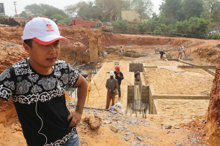 Chinese and Nigerian construction workers work on a site in Niamey, Niger, on February 22, 2016.