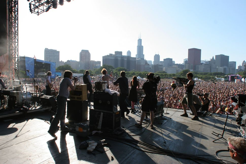 The Arcade Fire perform live in concert at Lollapalooza 2005 in Chicago, Illinois.