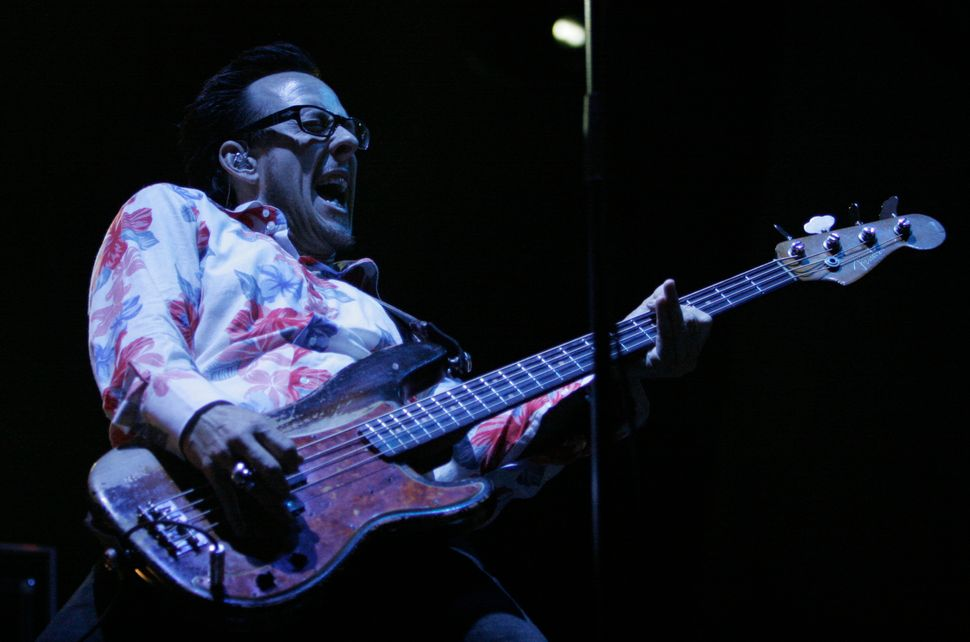 Bassist Scott Shriner of Weezer performs at Lollapalooza, July 23, 2005, in Chicago, Illinois.