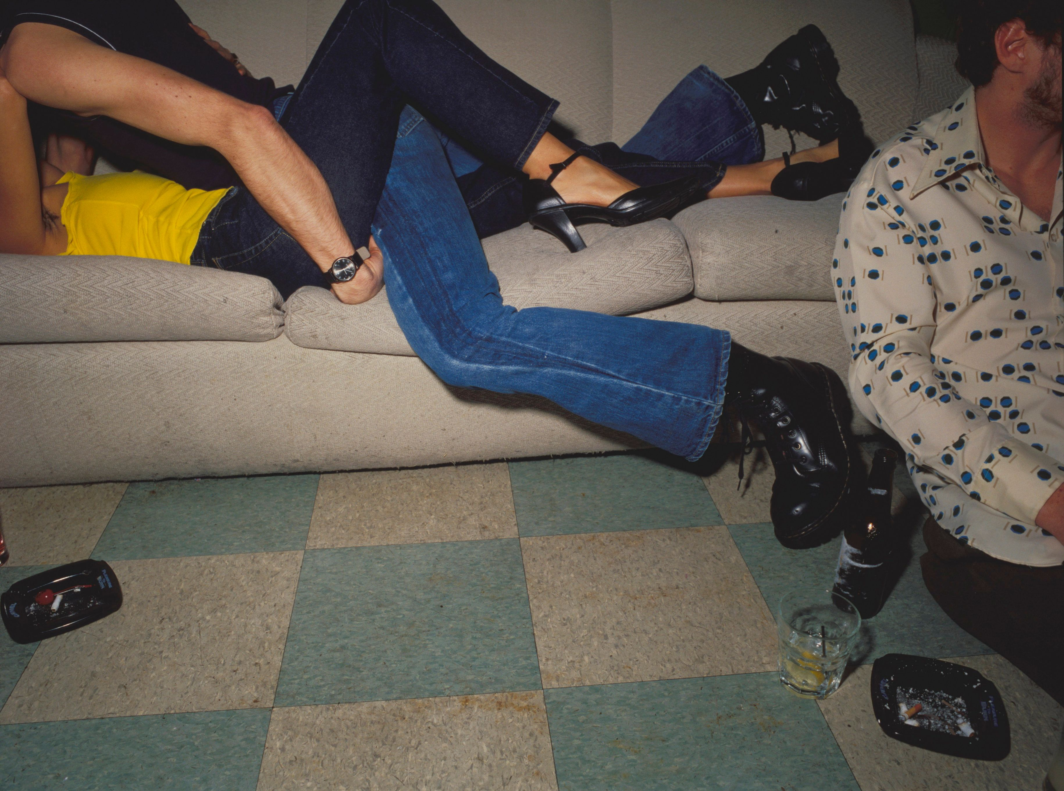 Couple embracing on couch at party
