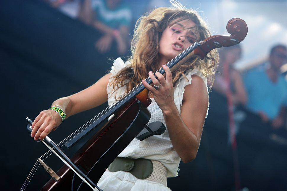 Alexandra Lawn of Ra Ra Riot performs onstage during the 2009 Lollapalooza music festival at Grant Park on August 9, 2009, in