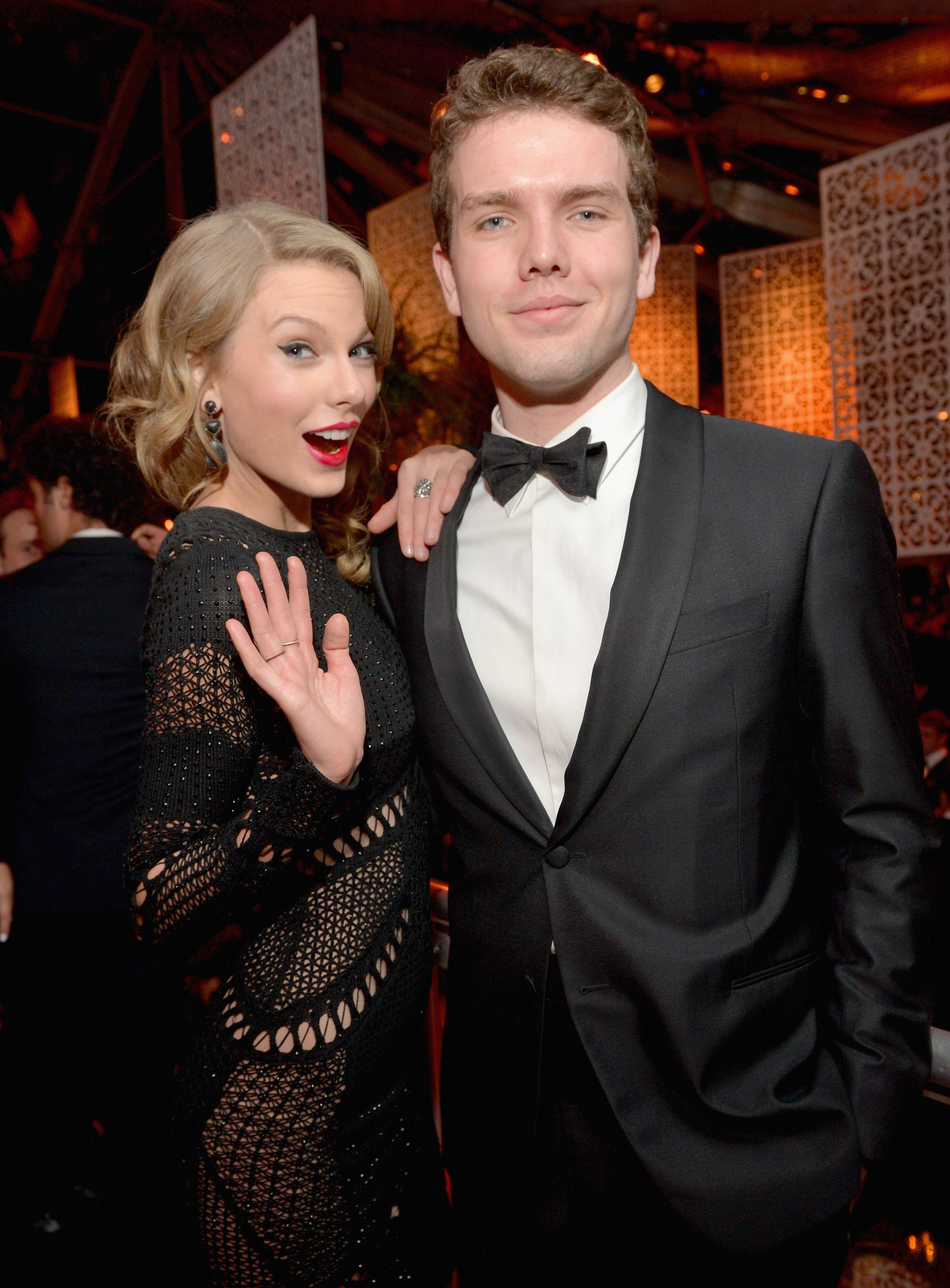 Singer Taylor Swift (L) and Austin Swift at The Beverly Hilton Hotel on Jan. 12, 2014 in Beverly Hills,