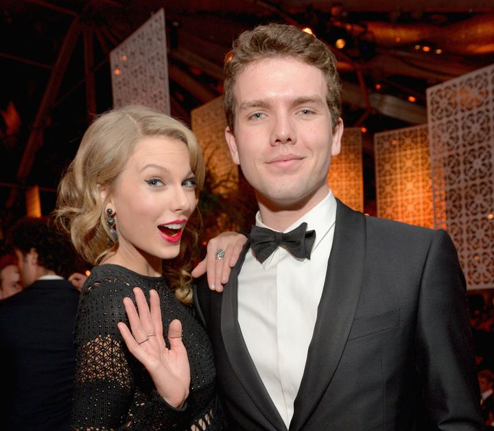 Singer Taylor Swift (L) and Austin Swift at The Beverly Hilton Hotel on Jan. 12, 2014 in Beverly Hills, CA.