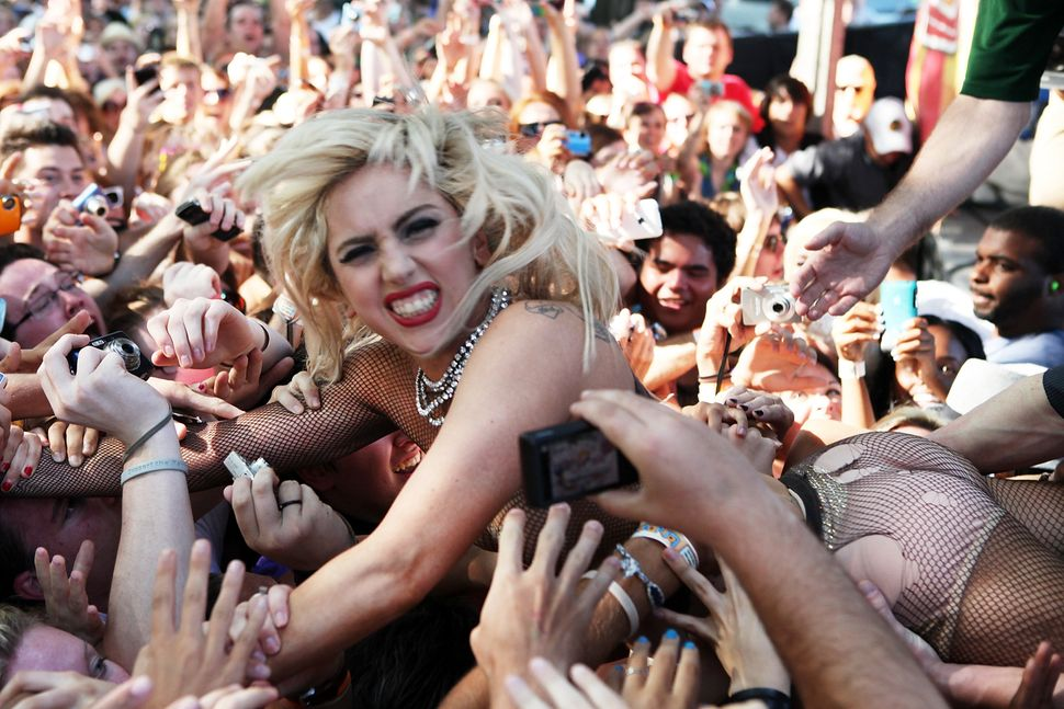 Lady Gaga jumps into the crowd during the performance of Semi Precious Weapons at Lollapalooza at Grant Park on Aug. 6, 2010,