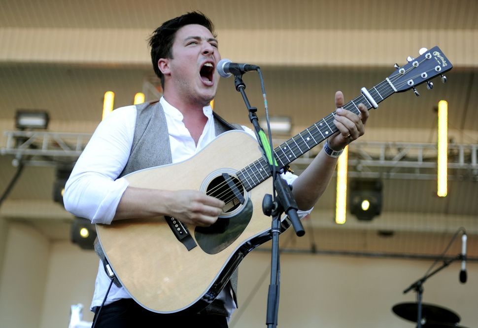 Marcus Mumford of Mumford & Sons performs as part of Lollapalooza 2010 at Grant Park on Aug. 8, 2010 in Chicago, Illinois