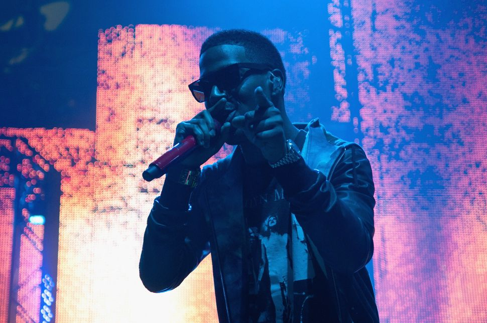 Kid Cudi performs on stage during Lollapalooza Festival 2011 at Grant Park in Chicago, Illinois.