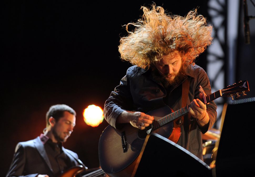 Jim James (R) of My Morning Jacket performs as part of Lollapalooza 2011 - Day 2 at Grant Park in Chicago, Illinois.