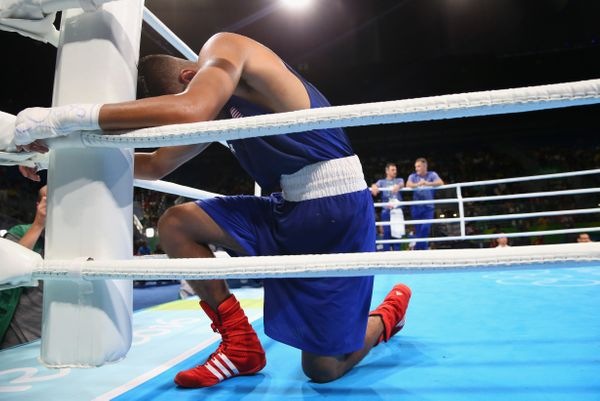 Carlos Zenon Balderas Jr of USA prays in a corner after a fight against Lazaro Jorge Alvarez of Cuba in the Men's Lightweight