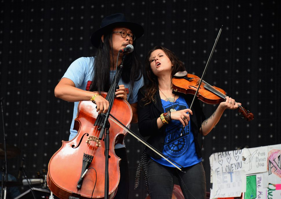 Joe Kwon and Tania Elizabeth of The Avett Brothers perform at Samsung Galaxy stage during 2014 Lollapalooza - Day 3 at G
