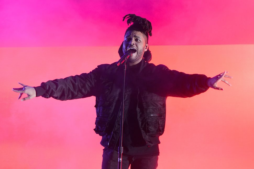 The Weeknd performs during Lollapalooza 2015 at Grant Park on July 31, 2015, in Chicago, Illinois.