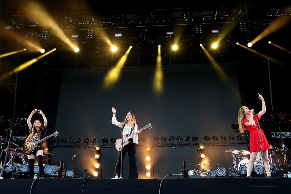 Alana Haim, Danielle Haim and Este Haim of the band Haim perform in concert on Day 4 of the 25th anniversary Lollapalooza at